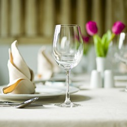 Table setting with plate and glass